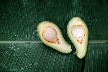 sliced avocado fruit on a banana leaf